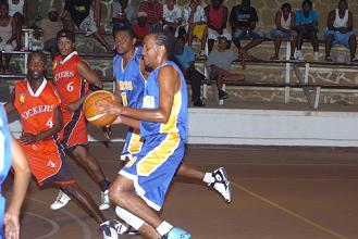 Bertin, with ball, had the hot hands for Cobras with 25 points including seven treys