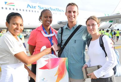 The 100,000th visitor – Sed and wife – are welcome by STB staff at the Seychelles International Airport