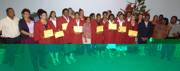The group of newly graduated nurses in a souvenir photograph with some of the guests who attended the ceremony