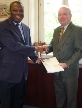Mr Morin (right) presents Mr Osakwe with Seychelles' Memorandum of Foreign Trade Regime