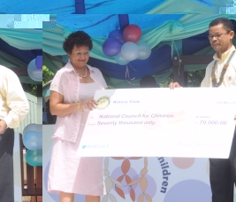Mrs Mondon accepts the cheque from Mr Bonnelame