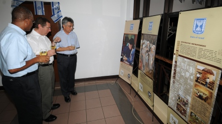 (From l to r): PS Nourrice, Mr Keidar and Minister Shamlaye viewing the exhibition