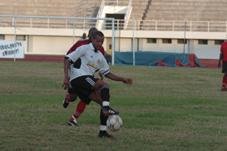 Sunshine scorer Belle shields the ball from a St Michel defender