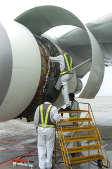 The engineers checking one of the engines at Seychelles International Airport on Tuesday