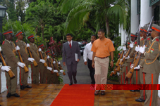 H.E. Ajay Bramdeo (left) is greeted by a 14-man Guard of Honour on his way to presenting his credentials to President Michel