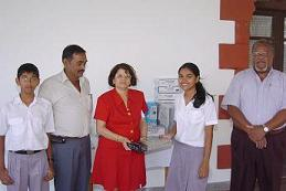 Dr Shobba accepting the donation from Janita Shah. (Inset) The late Mr Ravilal Shah