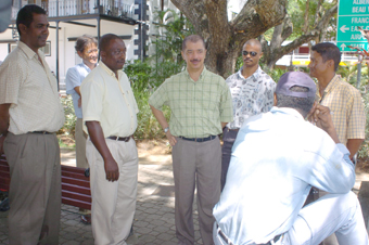 President Michel (centre) chatting with taxi drivers  (photo left) and crossing the street along Independence Avenue