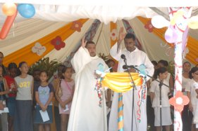 Father Gappy (left) and Rev. Elizabeth giving their blessing to the Child Protection Week activities