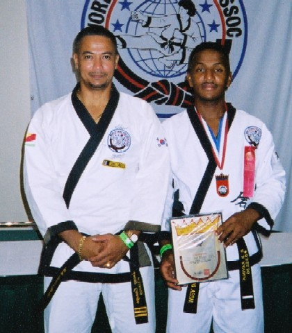 Kata with weapon gold medallist Ravinia (right) with Canaya