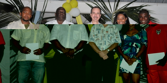 Minister Morgan and Commissioner Quatre in a souvenir photograph with the three athletes – Terrence Dixie (left), Janet Georges and Keddy Agnes (right