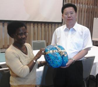 Mrs Alexis hands Mr Li Jinyuan an artistic coco de mer nut