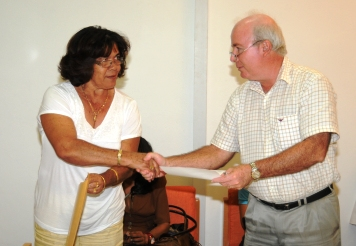 Mrs Carpin receives the certificates for PDM candidates from chief electoral officer Charles Morin