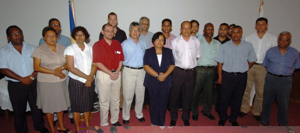 Representatives of the private sector who have sponsored scholarships in a souvenir photograph with former Education Minister Bernard Shamlaye, members of the university's board and its deans of faculties