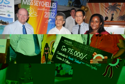 Mr Choo and STB chief executive Alain St Ange look on as Ms Tirant presents the cheque to Minister Shamlaye
