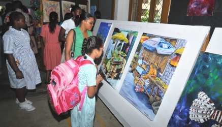 Guests and students viewing the displays in the exhibition