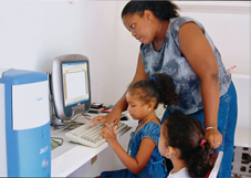 Youngsters learning computer skills at the centre