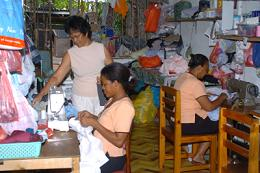 Rosalene Sinon (standing) runs a tailoring business at home where she employs two workers
