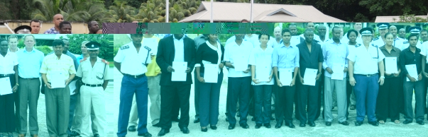 The certificate recipients in a souvenir photograph with guests at the end of the training