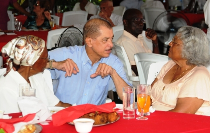 Pictured here with two elders of our country, President Michel has urged them to continue to educate the younger generations