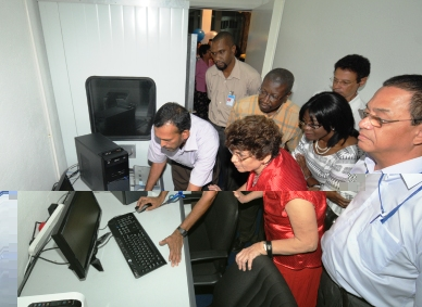 Guests getting acquainted to the equipment in the new audio booth donated by the SCAA