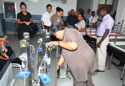 Minister Athanasius and other guests looking at some of the equipment inside the Anse Royale hospital