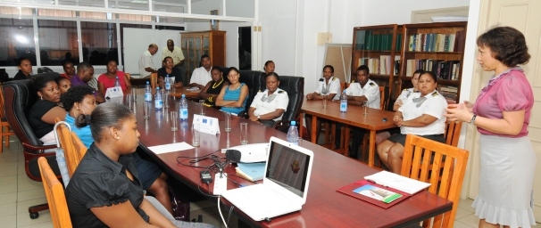 Ms Lafortune (standing) explaining the importance of ethics to officials of the Customs Division