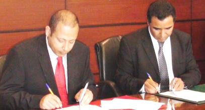 Messrs Simeon (left) and Chiguer signing the documents