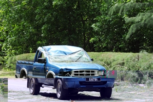 The badly damaged pickup