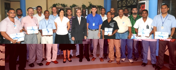 SCAA workers after receiving their certificates in the presence of Messrs Abandeh, Faure and Mondon