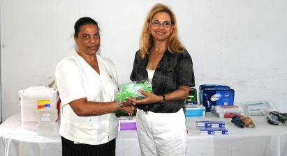Mrs Church hands over the donation to Mrs Hoareau
