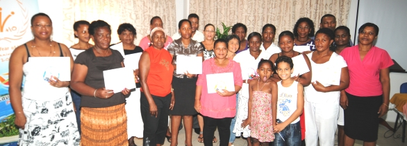 The certificate recipients in a souvenir photograph with course organisers and lecturers