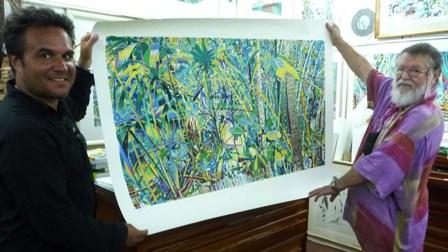 Mr Robert receives a souvenir painting from Michael Adams
