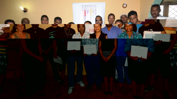 Those who followed the workshop in a souvenir photo with Mr Atangana (second from left) and Ms Rose (centre) after the certificate presentation