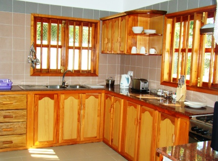 The interior of a kitchen where local timber has been widely used