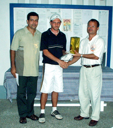 Winner Weidner (centre) receives his prize from Mr esparon as club captain Rizvi looks on