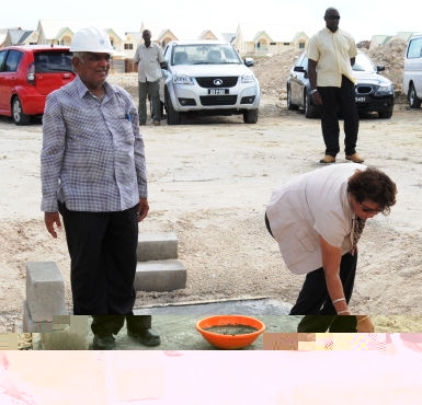 Mrs Mondon laying the foundation stone for the new school