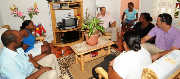 The delegation visiting one of the families who have recently moved into their new home