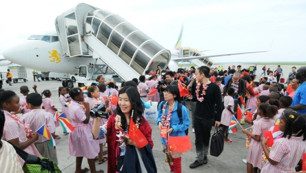 School children welcoming the Chinese tourists on their arrival at the Seychelles International Airport yesterday
