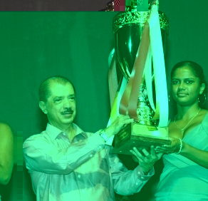 President Michel presents Camille with the Sportswoman of the Year title