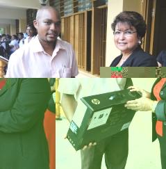 Minister Mondon presents deputy head Marc Arissol with his reward