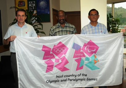 From left to right: Messrs Forbes, Meriton and Gopal holding the London Olympics flag