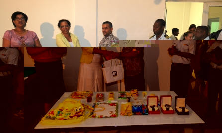 Mrs Delcy accepting the donation from Colonel Alzaabi
