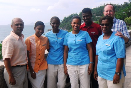 Mr Rahim (left) and Mr Porteous (right) congratulate employees Vanessa Brutus, Taciana Servina, Mary Zialor, Christoper Luc and Rosemay Quatre (from left to right)  on a job well done
