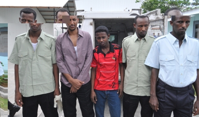 The five Somalis shortly before boarding the IDC-chartered plane to Somalia yesterday