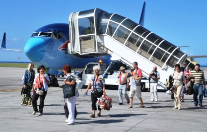 Passengers disembarking from the Boeing 737 chartered plane from Hungary