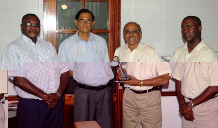 Mr Patel (second right) shows off his trophy in the presence of Messrs Célestine, Gopal and Alcindor