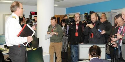 Commander Potts taking reporters around the headquarters