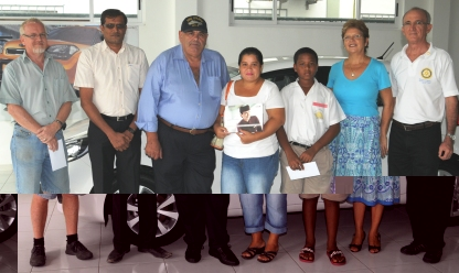 The winners in a souvenir photograph with sponsors and lottery organisers