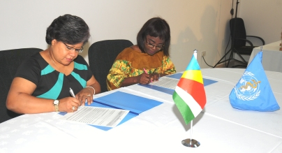 Minister Athanasius (left) and Dr Atsyor signing the joint WHO-Ministry of Health plan of action