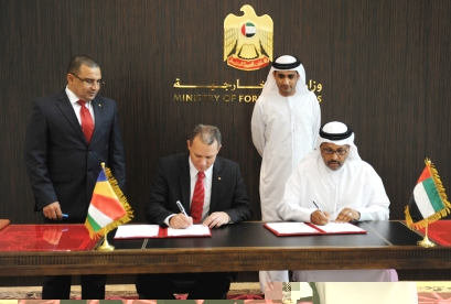 Minister Adam and Mr Junaibi signing the agreement